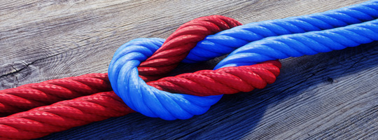 Red and blue rope tied in a knot